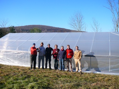 Work crew completing the hoophouse on a gorgeous Fall morning.